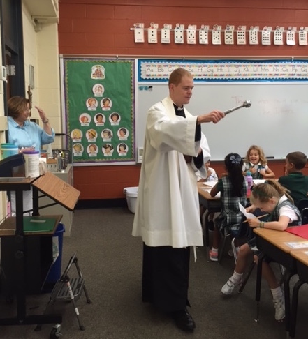 Fr. Skillman blessing SGM classrooms