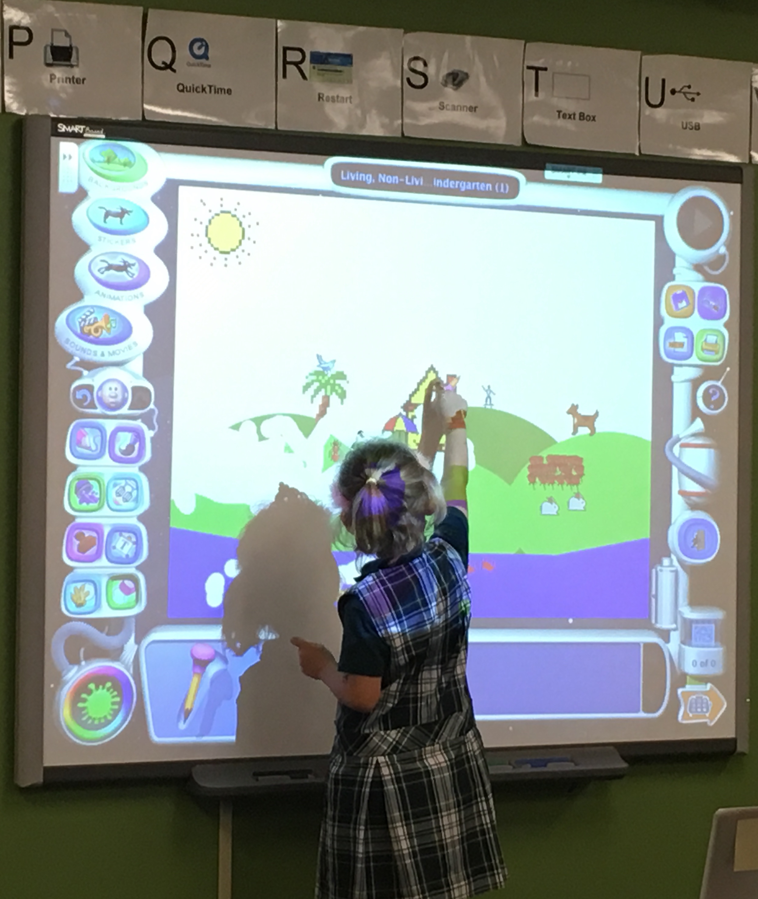 Kindergarten student using SmartBoard